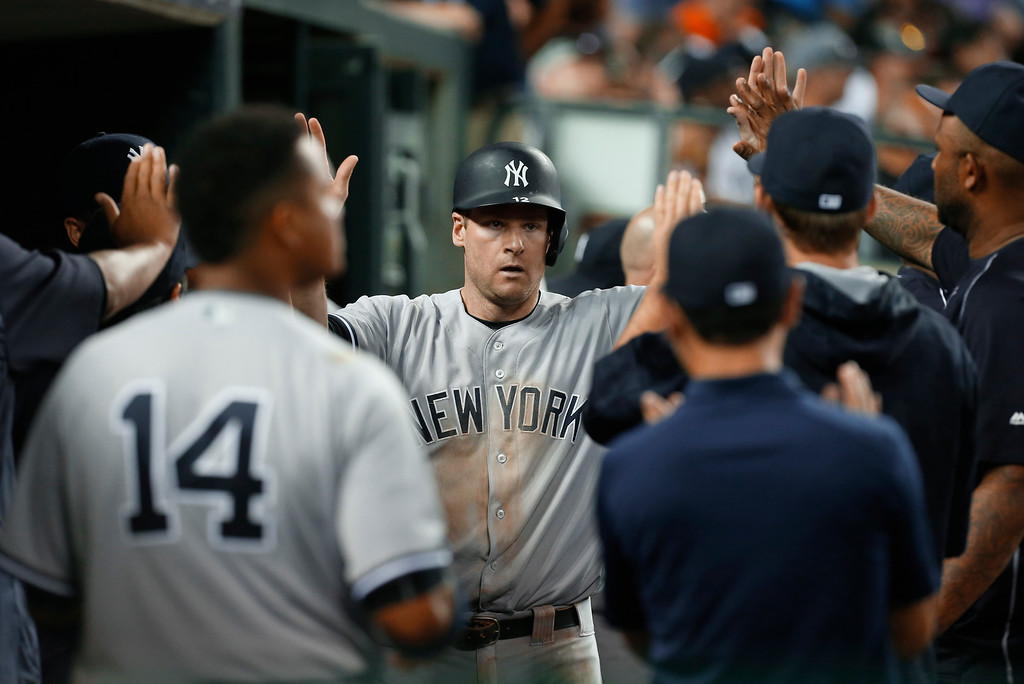 . New York Yankees\' Chase Headley is congratulated after scoring on a Robert Refsnyder single against the Detroit Tigers in the seventh inning of a baseball game in Detroit, Thursday, June 2, 2016. (AP Photo/Paul Sancya)
