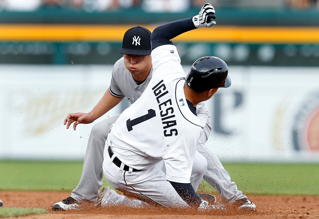 . New York Yankees second baseman Robert Refsnyder tags Detroit Tigers\' Jose Iglesias (1) out attempting to steal second base during the third inning of a baseball game in Detroit, Thursday, June 2, 2016. (AP Photo/Paul Sancya)