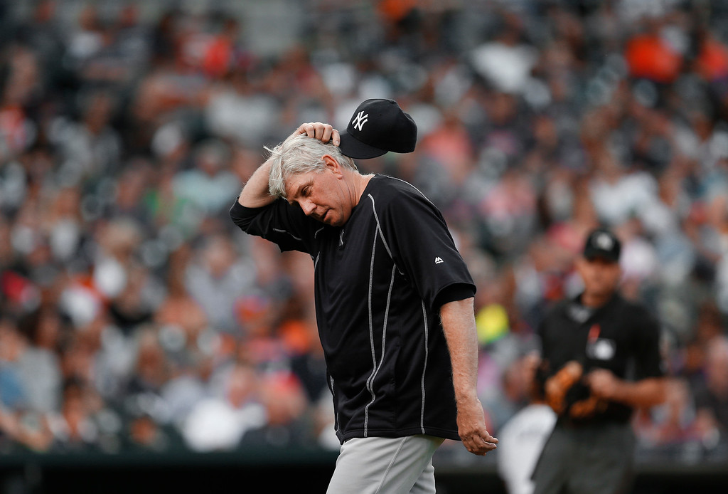 . New York Yankees pitching coach Larry Rothschild scratches his head after talking with pitcher Michael Pineda during the fourth inning of a baseball game against the Detroit Tigers in Detroit, Thursday, June 2, 2016. (AP Photo/Paul Sancya)
