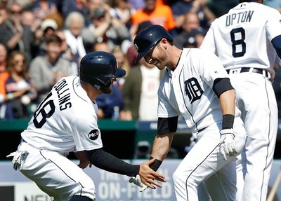 . Detroit Tigers\' Andrew Romine is greeted at home by Tyler Collins after a grand slam during the fourth inning of a baseball game against the Minnesota Twins, Wednesday, April 12, 2017, in Detroit. (AP Photo/Carlos Osorio)