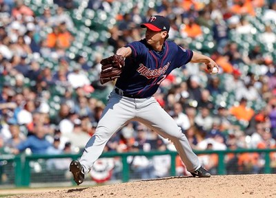 . Minnesota Twins relief pitcher Craig Breslow throws during the eighth inning of a baseball game against the Detroit Tigers, Wednesday, April 12, 2017, in Detroit. (AP Photo/Carlos Osorio)