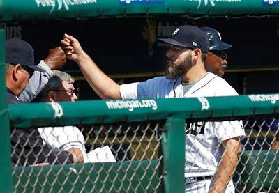 . Detroit Tigers starting pitcher Michael Fulmer greets teammates after the seventh inning of a baseball game against the Minnesota Twins, Wednesday, April 12, 2017, in Detroit. (AP Photo/Carlos Osorio)