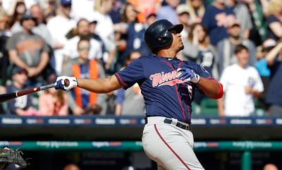 . Minnesota Twins\' Eduardo Escobar flies out to end the ninth inning of a baseball game against the Detroit Tigers, Wednesday, April 12, 2017, in Detroit. (AP Photo/Carlos Osorio)