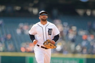 . Detroit Tigers right fielder Tyler Collins runs to the dugout during the first inning of a baseball game against the Minnesota Twins, Wednesday, April 12, 2017, in Detroit. (AP Photo/Carlos Osorio)