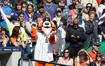 . Paws, the Detroit Tigers mascot leads fans in a cheer during the ninth inning of a baseball game against the Minnesota Twins, Wednesday, April 12, 2017, in Detroit. (AP Photo/Carlos Osorio)