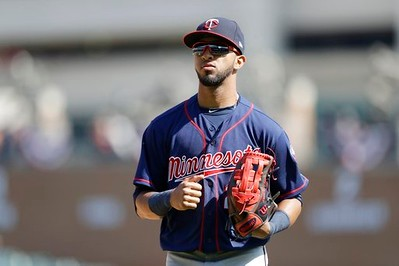 . Minnesota Twins center fielder Eddie Rosario runs to the dugout during the eighth inning of a baseball game against the Detroit Tigers, Wednesday, April 12, 2017, in Detroit. (AP Photo/Carlos Osorio)