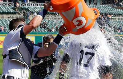 . Detroit Tigers catcher James McCann pours water on center fielder Andrew Romine after the baseball game against the Minnesota Twins, Wednesday, April 12, 2017, in Detroit. Romine hit a grand slam to lead the Tigers to a 5-3 win. (AP Photo/Carlos Osorio)