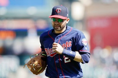 . Minnesota Twins second baseman Brian Dozier runs to the dugout during the eighth inning of a baseball game against the Detroit Tigers, Wednesday, April 12, 2017, in Detroit. (AP Photo/Carlos Osorio)