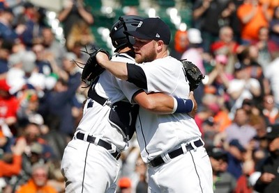. Detroit Tigers relief pitcher Alex Wilson hugs catcher James McCann after a baseball game against the Minnesota Twins, Wednesday, April 12, 2017, in Detroit. (AP Photo/Carlos Osorio)