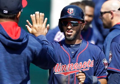 . Minnesota Twins\' Eddie Rosario greets teammates after scoring during the third inning of a baseball game against the Detroit Tigers, Wednesday, April 12, 2017, in Detroit. (AP Photo/Carlos Osorio)