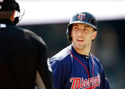 . Minnesota Twins\' Jason Castro disputes a strike three call with home plate umpire Chris Conroy during the second inning of a baseball game against the Detroit Tigers, Wednesday, April 12, 2017, in Detroit. (AP Photo/Carlos Osorio)