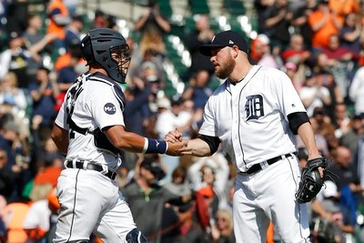 . Detroit Tigers catcher James McCann greets relief pitcher Alex Wilson after the Tigers defeated the Minnesota Twins 5-3 in a baseball game, Wednesday, April 12, 2017, in Detroit. (AP Photo/Carlos Osorio)