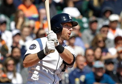 . Detroit Tigers\' Andrew Romine follows through on his grand slam during the fourth inning of a baseball game against the Minnesota Twins, Wednesday, April 12, 2017, in Detroit. (AP Photo/Carlos Osorio)