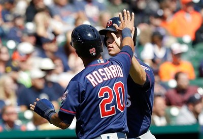 . Minnesota Twins\' Eddie Rosario greets Max Kepler after they both scored on a hit by Brian Dozier during the third inning of a baseball game against the Detroit Tigers, Wednesday, April 12, 2017, in Detroit. (AP Photo/Carlos Osorio)