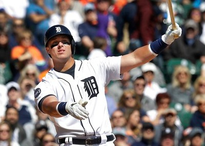 . Detroit Tigers\' James McCann follows through on a swing during the fourth inning of a baseball game against the Minnesota Twins, Wednesday, April 12, 2017, in Detroit. (AP Photo/Carlos Osorio)