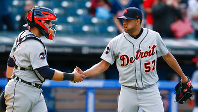 . Detroit Tigers relief pitcher Francisco Rodriguez (57) and Alex Avila celebrate a 4-1 victory over the Cleveland Indians in a baseball game, Sunday, April 16, 2017, in Cleveland. (AP Photo/Ron Schwane)