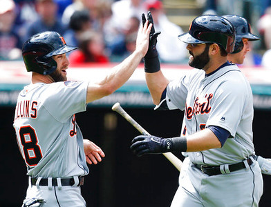 . Detroit Tigers\' Alex Avila, left, gets congratulations from Tyler Collins after hitting a two run home run off Cleveland Indians starting pitcher Carlos Carrasco during the second inning in a baseball game, Sunday, April 16, 2017, in Cleveland. (AP Photo/Ron Schwane)