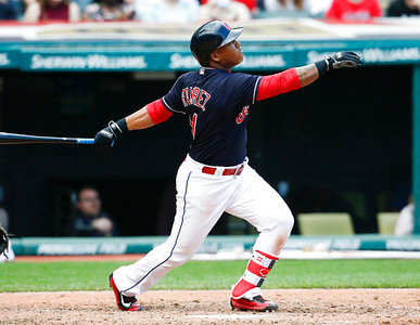 . Cleveland Indians\' Jose Ramirez hits a sacrifice fly during the sixth inning in a baseball game, Sunday, April 16, 2017, in Cleveland. The Tigers won 4-1. (AP Photo/Ron Schwane)
