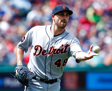 . Detroit Tigers starting pitcher Matt Boyd toss the ball to first base to get out Cleveland Indians\' Edwin Encarnacion during the second inning in a baseball game, Sunday, April 16, 2017, in Cleveland. (AP Photo/Ron Schwane)