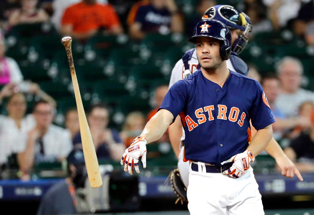 . Houston Astros\' Jose Altuve tosses his bat after striking out to end the first inning of a baseball game Sunday, July 15, 2018, in Houston. (AP Photo/David J. Phillip)