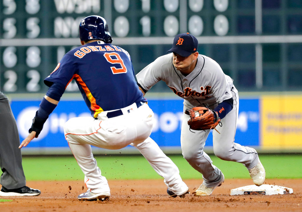 . Houston Astros\' Marwin Gonzalez (9) is tagged out by Detroit Tigers shortstop Jose Iglesias while trying to steal second base during the fourth inning of a baseball game Sunday, July 15, 2018, in Houston. (AP Photo/David J. Phillip)