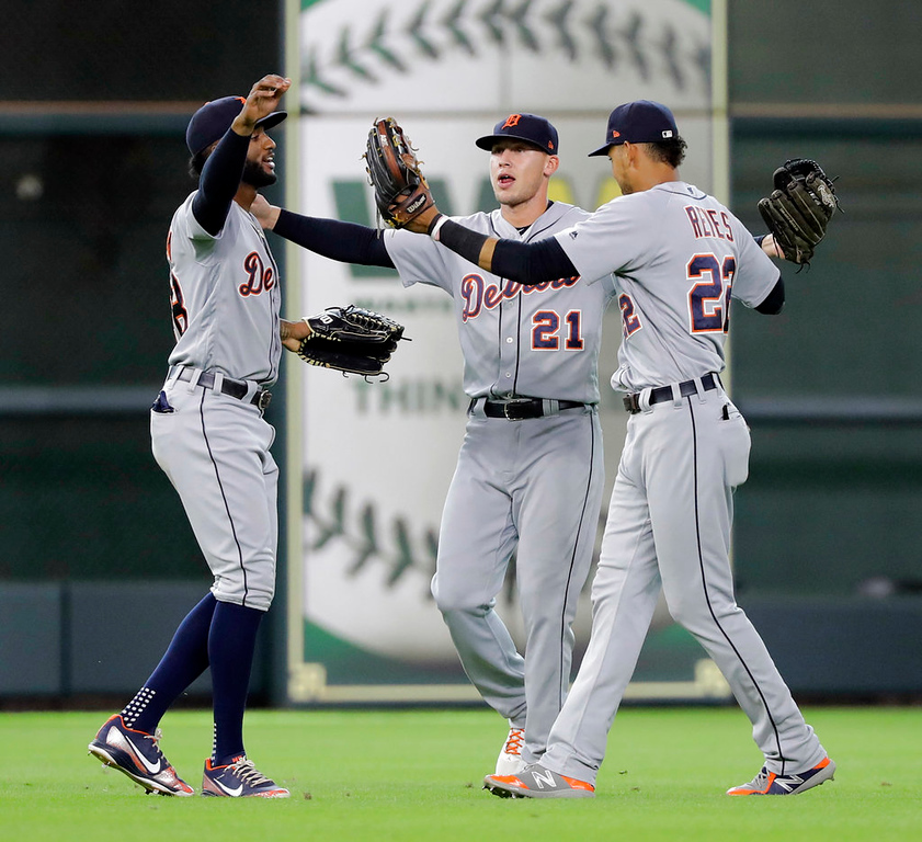 . Detroit Tigers\' JaCoby Jones (21), Victor Reyes (22) and Niko Goodrum celebrate after a baseball game against the Houston Astros, Sunday, July 15, 2018, in Houston. (AP Photo/David J. Phillip)