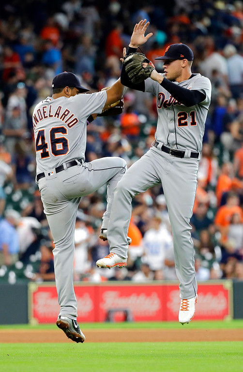 . Detroit Tigers\' Jeimer Candelario (46) and JaCoby Jones (21) celebrate after a baseball game against the Houston Astros, Sunday, July 15, 2018, in Houston. (AP Photo/David J. Phillip)
