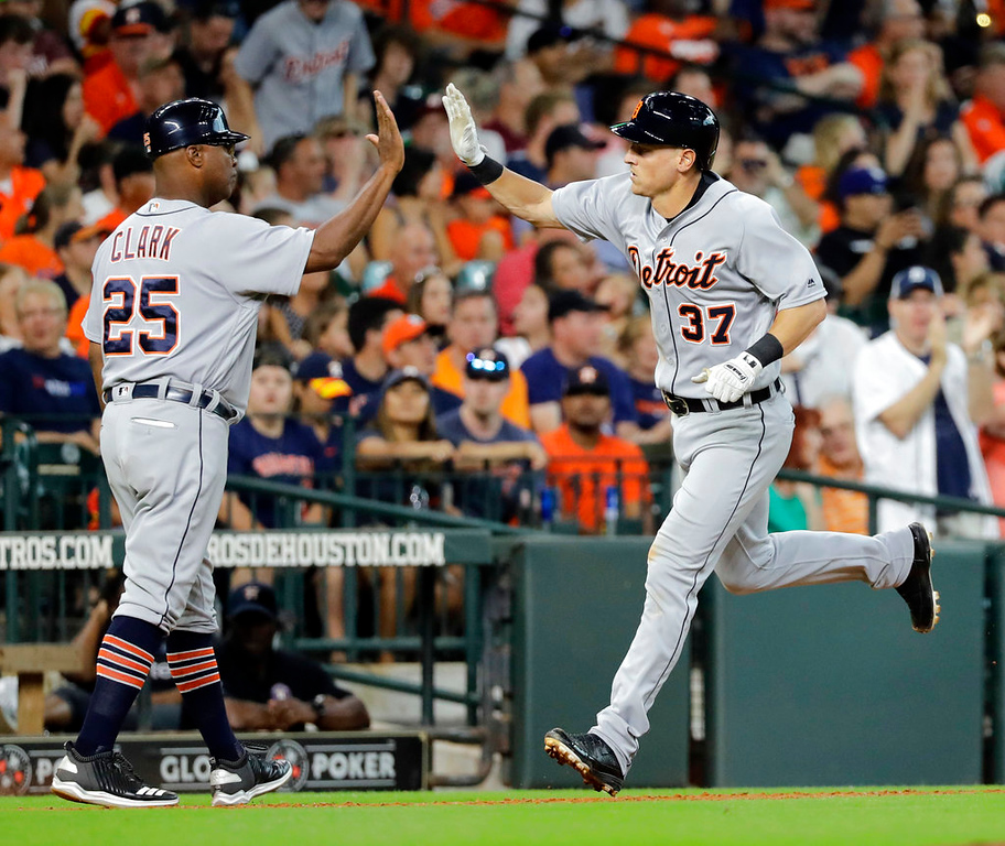 . Detroit Tigers\' Jim Adduci (37) is congratulated by third base coach Dave Clark (25) after hitting a home run against the Houston Astros during the sixth inning of a baseball game Sunday, July 15, 2018, in Houston. (AP Photo/David J. Phillip)