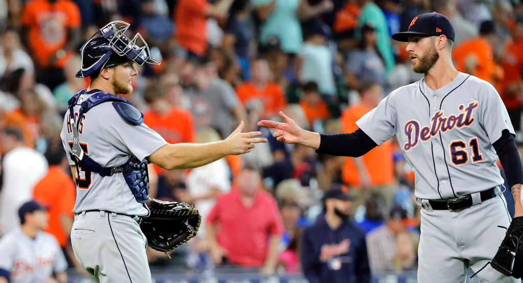 . Detroit Tigers\' Shane Greene (61) and John Hicks celebrate after a baseball game against the Houston Astros, Sunday, July 15, 2018, in Houston. (AP Photo/David J. Phillip)