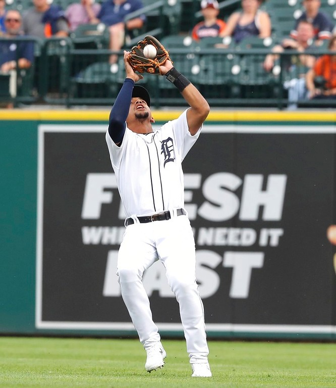 . Detroit Tigers shortstop Dixon Machado catches the popup hit by Oakland Athletics\' Marcus Semien during the first inning of a baseball game, Tuesday, June 26, 2018, in Detroit. (AP Photo/Carlos Osorio)