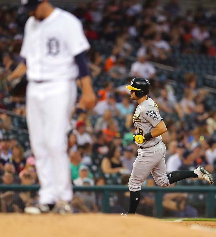 . Oakland Athletics\' Chad Pinder (18) rounds the bases after his two-run home run as Detroit Tigers starting pitcher Blaine Hardy stands on the mound during the fifth inning of a baseball game, Tuesday, June 26, 2018, in Detroit. (AP Photo/Carlos Osorio)