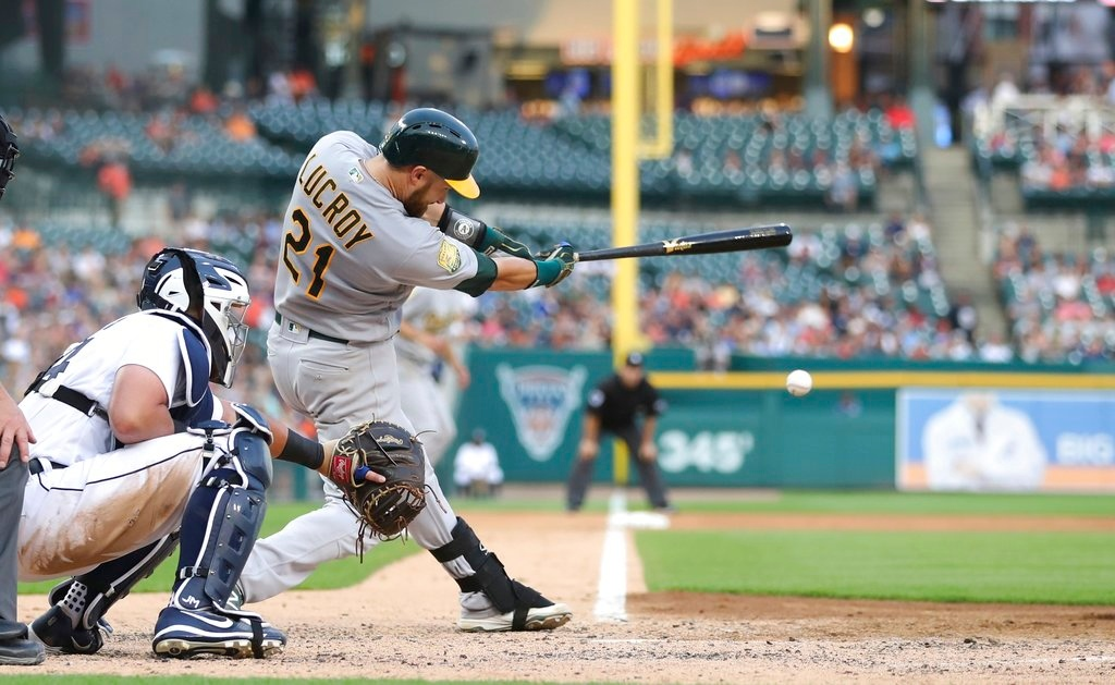. Oakland Athletics\' Jonathan Lucroy connects for a two-run double to left field during the fourth inning against the Detroit Tigers in a baseball game Tuesday, June 26, 2018, in Detroit. (AP Photo/Carlos Osorio)