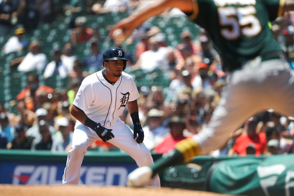 . Detroit Tigers\' Jeimer Candelario leads off first as Oakland Athletics starting pitcher Sean Manaea throws during the first inning of a baseball game, Thursday, June 28, 2018, in Detroit. (AP Photo/Carlos Osorio)