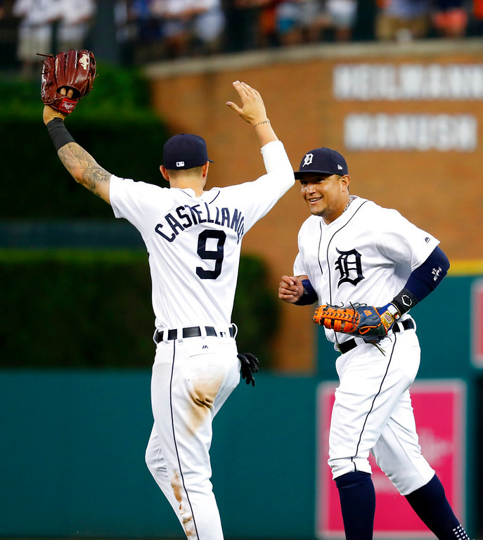 . Detroit Tigers\' Nicholas Castellanos (9) reacts to first baseman Miguel Cabrera (24) catching a Toronto Blue Jays\' Kevin Pillar fly ball in shallow right field in the sixth inning of a baseball game in Detroit, Friday, June 1, 2018. (AP Photo/Paul Sancya)