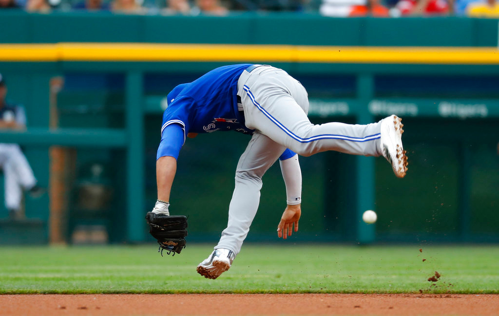 . Toronto Blue Jays shortstop Aledmys Diaz can\'t reach a Detroit Tigers\' Nicholas Castellanos ground ball in the first inning of a baseball game in Detroit, Friday, June 1, 2018. (AP Photo/Paul Sancya)
