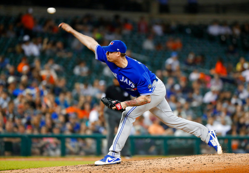 . Toronto Blue Jays relief pitcher John Axford throws against the Detroit Tigers in the eighth inning of a baseball game in Detroit, Friday, June 1, 2018. (AP Photo/Paul Sancya)