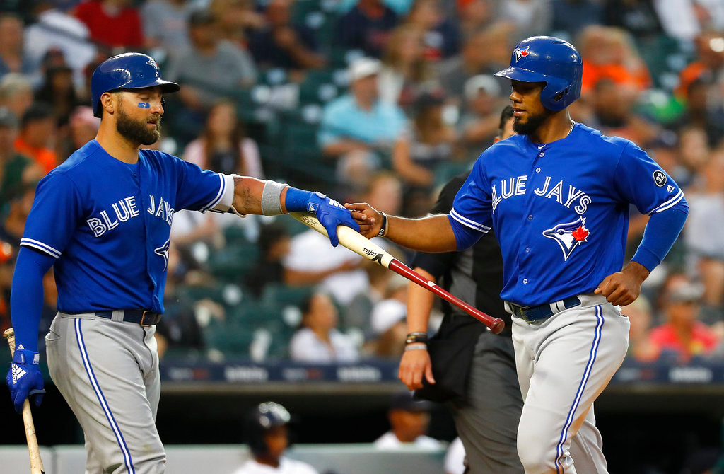 . Toronto Blue Jays\' Teoscar Hernandez, right, celebrates scoring with Kevin Pillar on a Kendrys Morales sacrifice fly in the sixth inning of a baseball game against the Detroit Tigers in Detroit, Friday, June 1, 2018. (AP Photo/Paul Sancya)