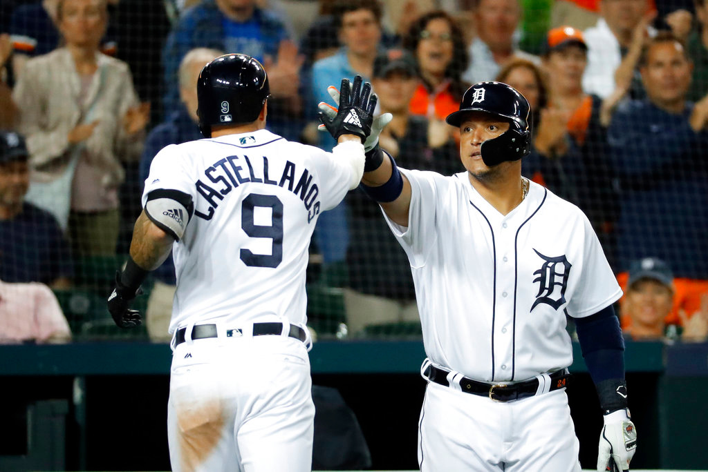 . Detroit Tigers\' Nicholas Castellanos (9) celebrates his solo home run with Miguel Cabrera in the seventh inning of a baseball game against the Toronto Blue Jays in Detroit, Friday, June 1, 2018. (AP Photo/Paul Sancya)