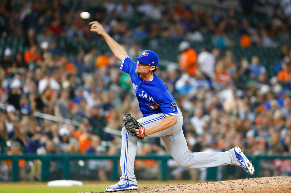 . Toronto Blue Jays relief pitcher Tyler Clippard throws in the seventh inning of a baseball game against the Detroit Tigers in Detroit, Friday, June 1, 2018. (AP Photo/Paul Sancya)
