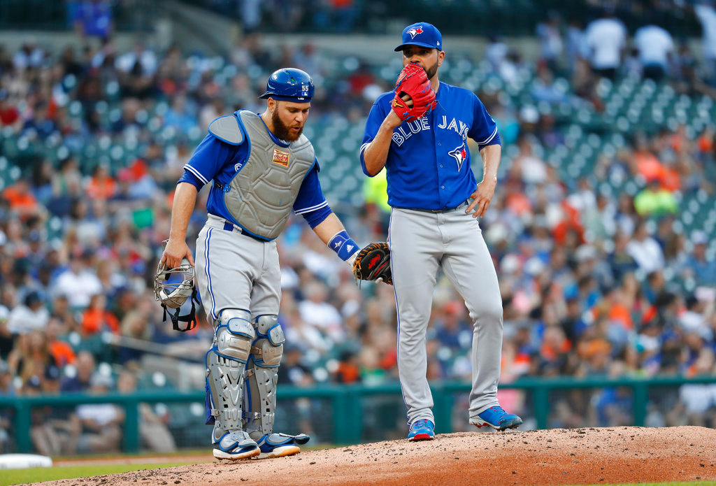 . Toronto Blue Jays catcher Russell Martin, left, visits pitcher Jaime Garcia in the second inning of a baseball game against the Detroit Tigers in Detroit, Friday, June 1, 2018. (AP Photo/Paul Sancya)