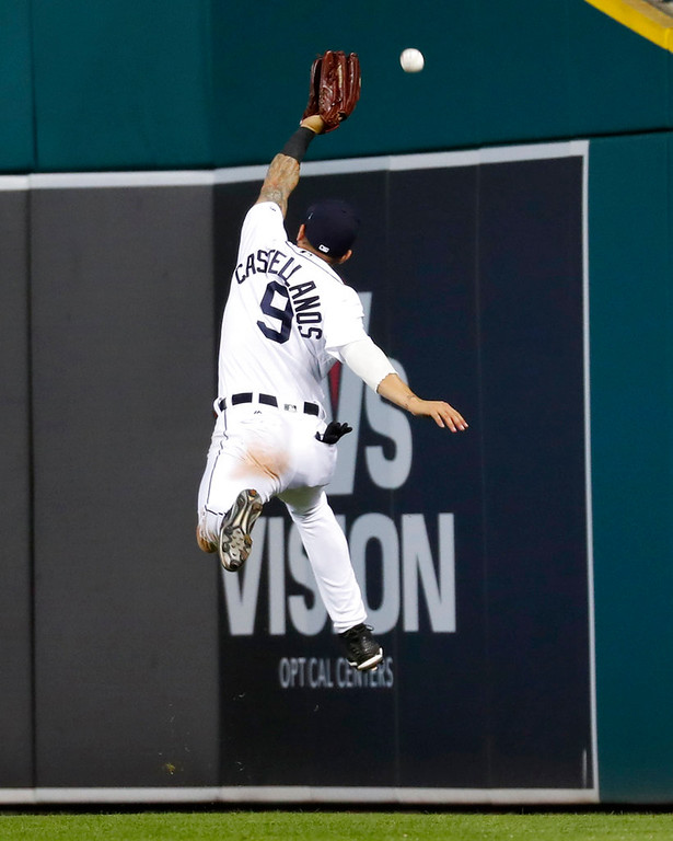 . Detroit Tigers right fielder Nicholas Castellanos jumps but can\'t reach a Toronto Blue Jays\' Aledmys Diaz ground rule double in the seventh inning of a baseball game in Detroit, Friday, June 1, 2018. (AP Photo/Paul Sancya)