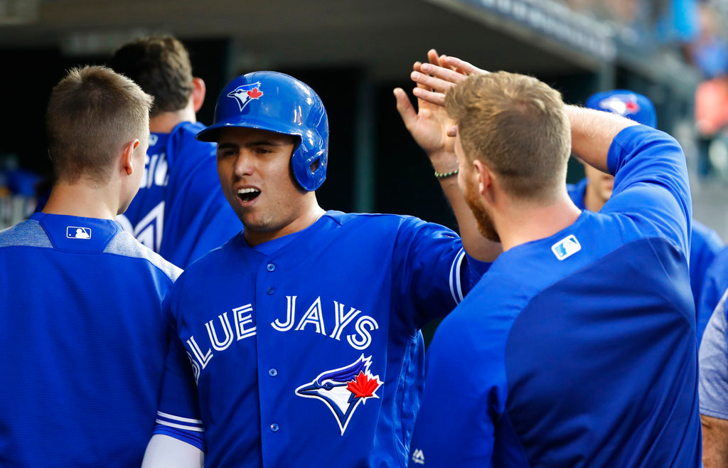 . Toronto Blue Jays\' Aledmys Diaz celebrates scoring on a Teoscar Hernandez triple in the sixth inning of a baseball game against the Detroit Tigers in Detroit, Friday, June 1, 2018. (AP Photo/Paul Sancya)