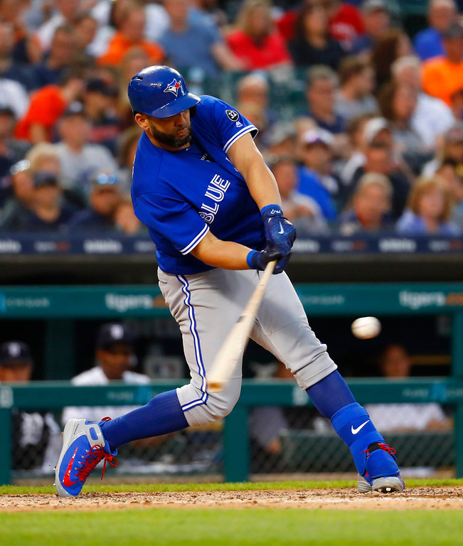 . Toronto Blue Jays\' Kendrys Morales hits a sacrifice fly in the sixth inning of a baseball game against the Detroit Tigers in Detroit, Friday, June 1, 2018. Teoscar Hernandez scored on the play. (AP Photo/Paul Sancya)