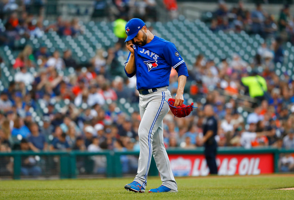 . Toronto Blue Jays pitcher Jaime Garcia walks to the dugout after being relieved in the second inning of a baseball game against the Detroit Tigers in Detroit, Friday, June 1, 2018. (AP Photo/Paul Sancya)