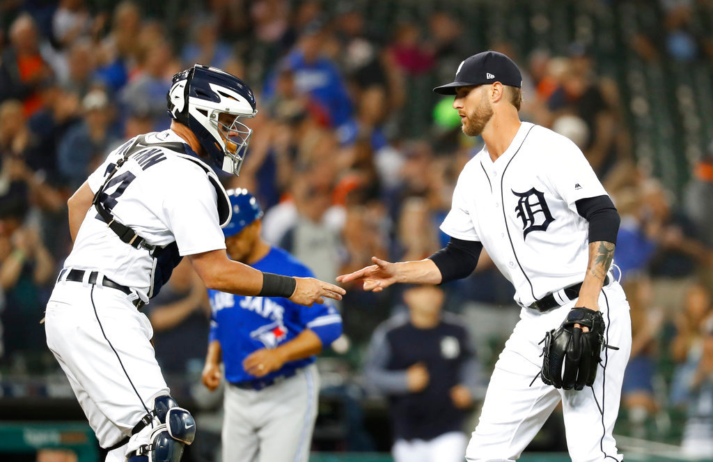 . Detroit Tigers catcher James McCann and relief pitcher Shane Greene (61) celebrate after a baseball game against the Toronto Blue Jays in Detroit, Friday, June 1, 2018. Detroit won 5-2. (AP Photo/Paul Sancya)