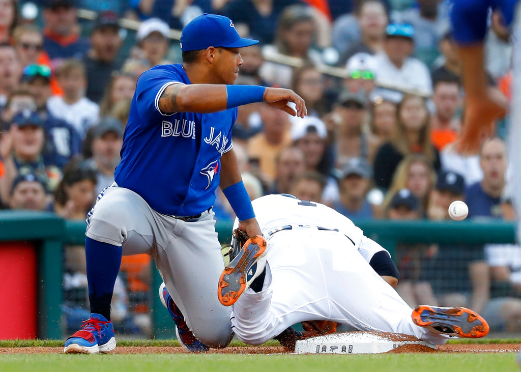 . Detroit Tigers\' Jose Iglesias steals third base as Toronto Blue Jays third baseman Yangervis Solarte loses the ball in the second inning of a baseball game in Detroit, Friday, June 1, 2018. (AP Photo/Paul Sancya)
