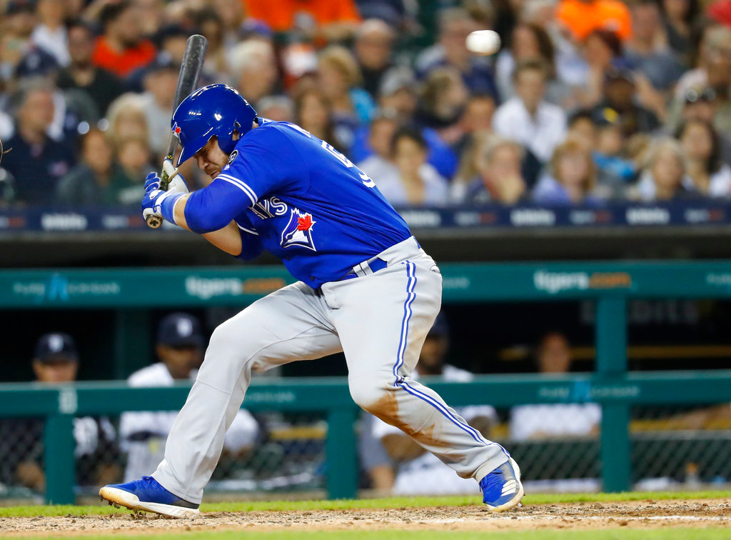 . Toronto Blue Jays\' Russell Martin ducks from a Detroit Tigers relief pitcher Johnny Barbato pitch in the eighth inning of a baseball game in Detroit, Friday, June 1, 2018. (AP Photo/Paul Sancya)