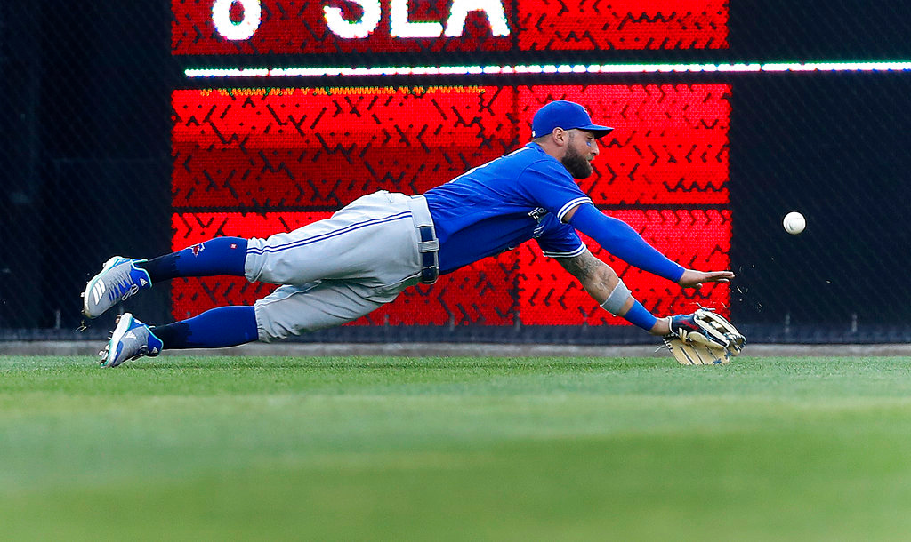 . Toronto Blue Jays center fielder Kevin Pillar dives but can\'t reach a Detroit Tigers\' JaCoby Jones two-run triple in the second inning of a baseball game in Detroit, Friday, June 1, 2018. (AP Photo/Paul Sancya)