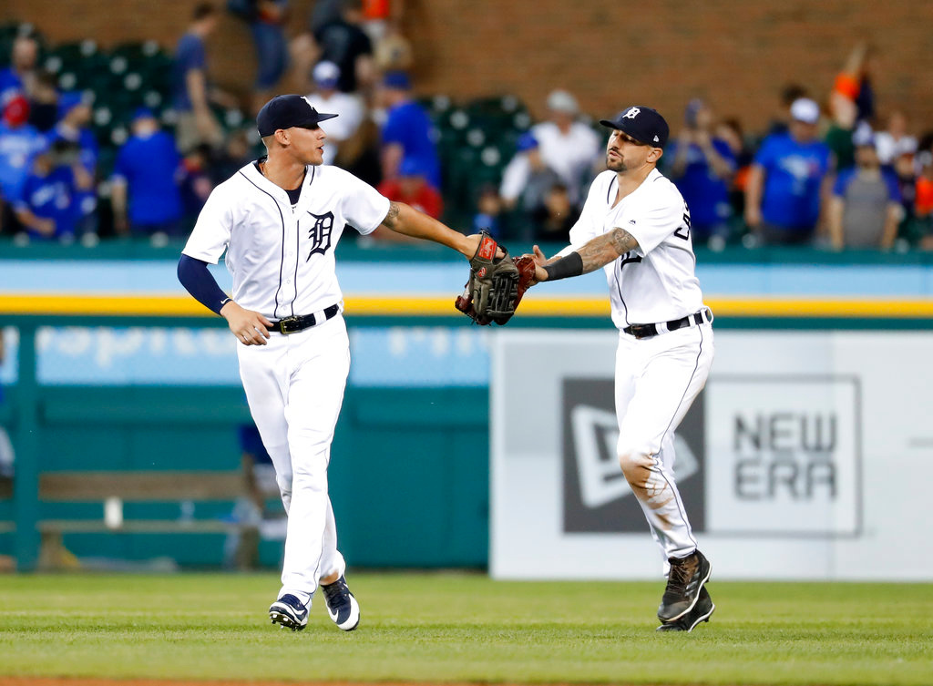. Detroit Tigers center fielder JaCoby Jones, left, and Nicholas Castellanos celebrate after beating the Toronto Blue Jays 5-2 in a baseball game in Detroit, Friday, June 1, 2018. (AP Photo/Paul Sancya)
