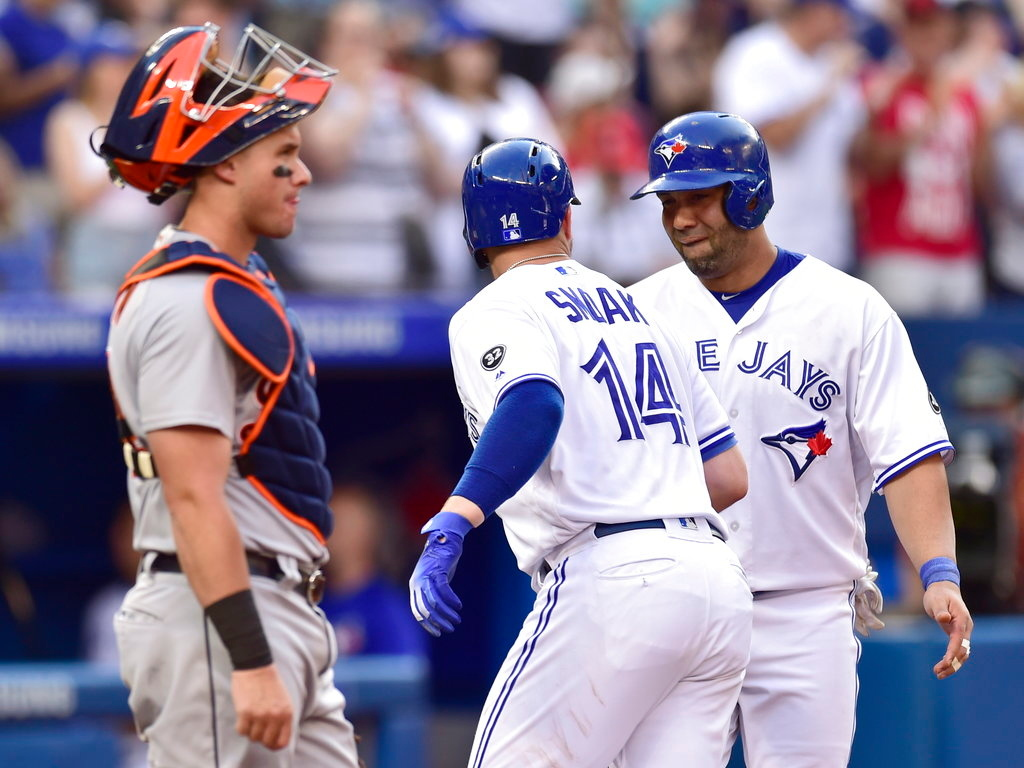 . Toronto Blue Jays\' Justin Smoak (14) celebrates his two-run home run with Kendrys Morales during the fourth inning of a baseball game against the Detroit Tigers on Friday, June 29, 2018, in Toronto. (Frank Gunn/The Canadian Press via AP)